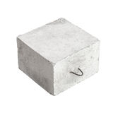 Big concrete construction block isolated. Big concrete construction block with metal lug isolated on white background Stock Image