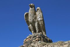 Big concrete eagle. On the road to Chatyr-Kul lake and china border, Torugart pass in naryn region, Kyrgyzstan Royalty Free Stock Photos