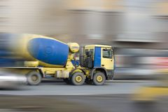 Big concrete mixer car rushing fast Stock Photo