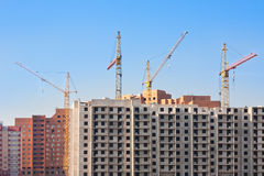 Big construction. Construction site with buildings and four tower cranes Royalty Free Stock Photo