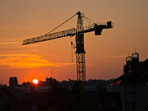 Big construction crane on a golden sunrise light in Belgrade Stock Image