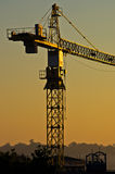 Big construction crane on resiodential construction site in crowded city area Royalty Free Stock Photography