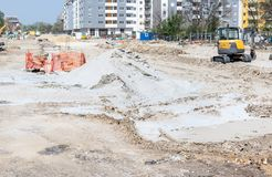 Big construction and reconstruction site with heavy excavator machinery earth mover bulldozer and digger repair asphalt road of th royalty free stock photos