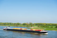Big container ship in Dutch landscape Royalty Free Stock Photos