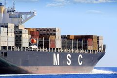 Big container ship MSC ABIDJAN sailing in open waters. The container ship MSC ABIDJAN after leaving the port of Valencia sailing in open waters Stock Photography