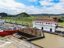 Big container Ship passes the panama canal building royalty free stock image