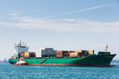 Big container ship with towboat Royalty Free Stock Photo
