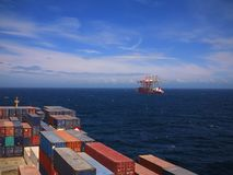 Big container vessel passing special crane transport vessel Stock Photography