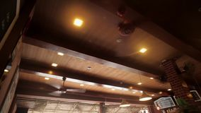 A big cooling ceiling fanin cafe stock video