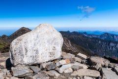 Big corner stone sitting at mountain tip Stock Images