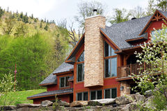 Big cottage on the hills Stock Photography
