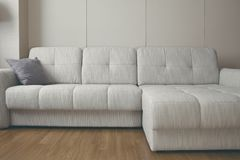 Big couch in the apartment drawing-room stock images