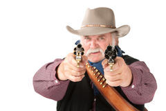 Big cowboy pointing pistols Stock Image