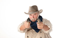 Big cowboy pointing two pistols Royalty Free Stock Images