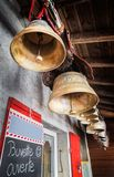 Swiss Cows Bells Hanging in Chalet as Decorations stock photos