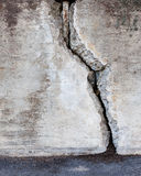 Big crack in concrete wall. Big crack in old messy concrete wall Royalty Free Stock Photo