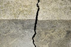Big crack on old concrete wall close up stock photos