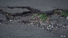 Big crack in the road surface. A big crack in the road surface stock video