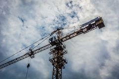 Big crane for building construction with cloudy sky as background photo taken in Jakarta Indonesia Stock Images