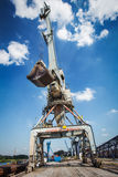 Big crane in the city river port. On the blue sky Royalty Free Stock Photo