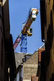 Big crane over the old center buildings Stock Photo