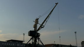 Big crane on standby on a dusky afternoon in the port GH4 4K stock video