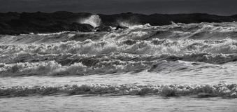 Big crashing waves in black and white stock images