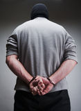 Big criminal locked in handcuffs Royalty Free Stock Photo