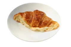 Big croissant on plate Stock Photo