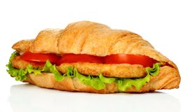 Big croissant with vegetables and chicken meat royalty free stock photography