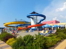 Big cross of helter-skelters. Summer fun at the pool with helters-skelters Royalty Free Stock Photo