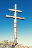 Big cross on the hill Dumbier in Low Tatras mountains, retro pho Royalty Free Stock Photography