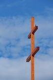 Big cross and a little bird Royalty Free Stock Photography