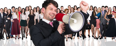 Big crowd of business people. And young businessman foreground. Isolated over white background Stock Photos