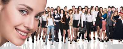 Big crowd of business people. And young women foreground. Isolated over white background Royalty Free Stock Photos