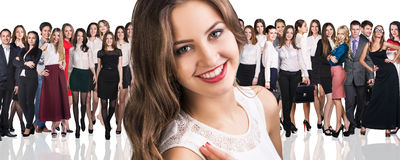 Big crowd of business people. And young women foreground. Isolated over white background Royalty Free Stock Photo