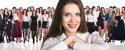 Big crowd of business people. And young women foreground. Isolated over white background Royalty Free Stock Image