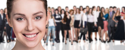 Big crowd of business people. And young women foreground. Isolated over white background Stock Photography