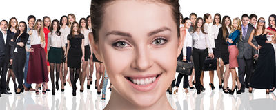 Big crowd of business people. And young women foreground.  over white background Royalty Free Stock Photos