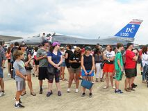 Big Crowd in Front of the F16. Photo of big crowd of people in front of an f16 jet fighter at andrews air force base in maryland during an air show on 9/16/17 Royalty Free Stock Images