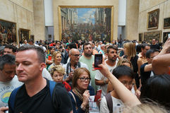 Big Crowd at at the Louvre Museum. Photo of many tourists at the louvre museum in paris france on 9/11/14.  This is in the room where the mona lisa is displayed Royalty Free Stock Photo