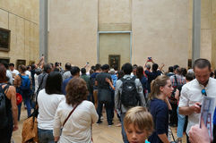 Big Crowd at the Mona Lisa. Photo of big crowd at the mona lisa painting in the louvre museum in Paris france on 9/11/14,  This painting is the most famous in Stock Photography