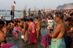 Big crowd of people in the river Ganges. Big crowd of indian people come to the confluence of the Ganges and the Yamuna during the biggest gathering on Earth Royalty Free Stock Images