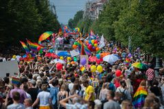 Big crowd of people supporting LGBT community in Baltic Pride event. People with rainbow stock image