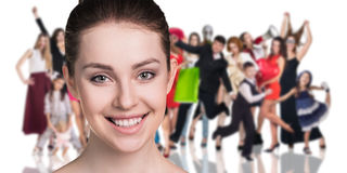 Big crowd of people. And young women foreground. Isolated over white background Stock Photography