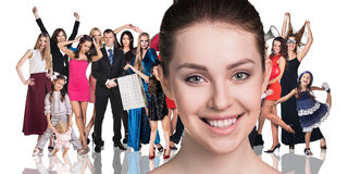 Big crowd of people. And young women foreground. Isolated over white background Stock Images
