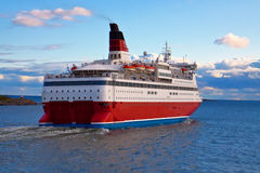 Big cruise liner. Scenic view of big cruise liner moving across the sea Stock Photography