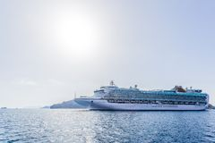 Big cruise liner goes from port Stock Image