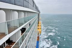 Big cruise liner and life boat stock images
