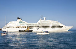 Big cruise liner and little yachts Stock Photography